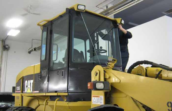 Replacing the windshield on a front end loader